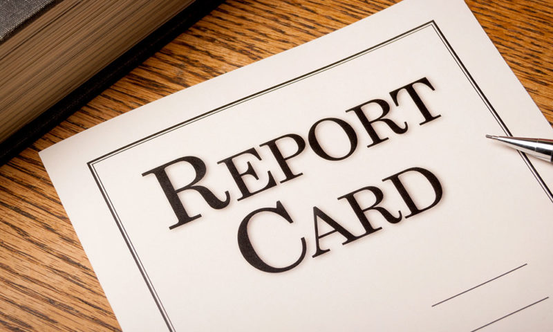 basic report card laying on table