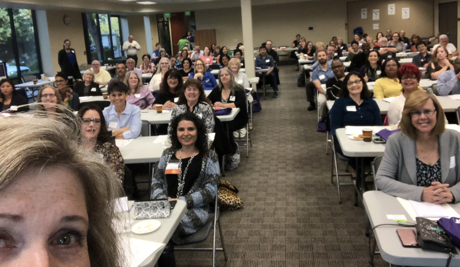 Selfie by Laura showing 2018 attendees at tables